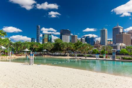 beach holiday: BRISBANE, AUS - NOV 18 2015: Streets Beach in South Bank Parkland. Its inner-city man-made beach next to city center.