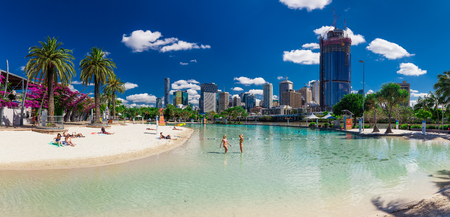 river banks: BRISBANE, AUS - NOV 18 2015: Streets Beach in South Bank Parkland. Its inner-city man-made beach next to city center.