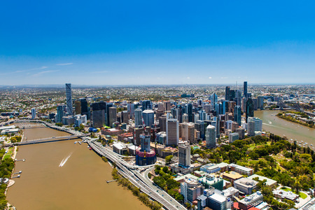 qld: BRISBANE, AUSTRALIA - NOVEMBER 11 2014: View of Brisbane from air over the river. Brisbane is the capital of QLD and the third largest city in Australia. November 11, 2014 Brisbane, Australia