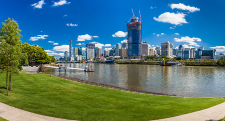 river banks: BRISBANE, AUS - NOV 18 2015: River walk in South Bank Parkland. Its inner-city man-made beach next to city center.