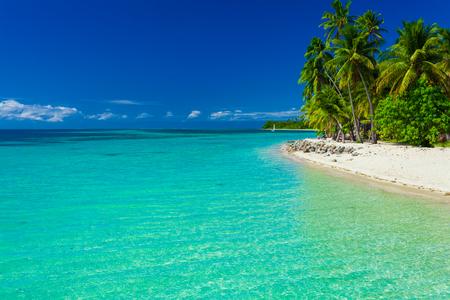 fiji: Tropical island in Fiji with sandy beach and clear lagoon Stock Photo