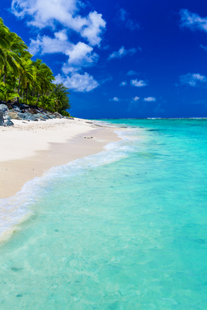 rarotonga: Tropical beach with rocks and palms on Cook Islands, Rarotonga Stock Photo