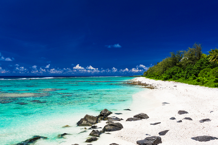 rarotonga: Amazing beach with white sand and black rocks on Rarotonga, Cook Islands Stock Photo