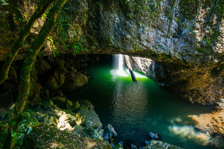 natural bridge: The Natural Bridge waterfall at Springbrook National Park in Queensland Australia Stock Photo