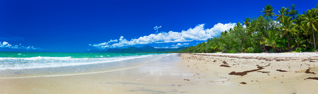 Port Douglas four mile beach and ocean on sunny day, north Queensland, Australia