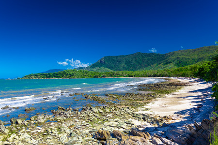 tribulation: Ellis Beach with rocks near Palm Cove and Cairns, Australia Stock Photo