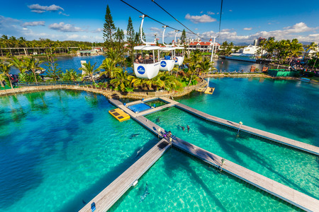 theme parks: GOLD COAST, AUS - JUL 21 2015: Visitors ride on Sky High Skyway in Sea World Gold Coast Australia. Its sea animals theme park that promote conservation of marine wildlife. Editorial