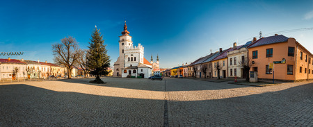 exterior shape: PODOLINEC, SLOVAKIA, 01 JAN 2016: Podolinec is a little historical ancient town in north part of Slovakia. View of the main square and the church of the Virgin Marys Ascension.