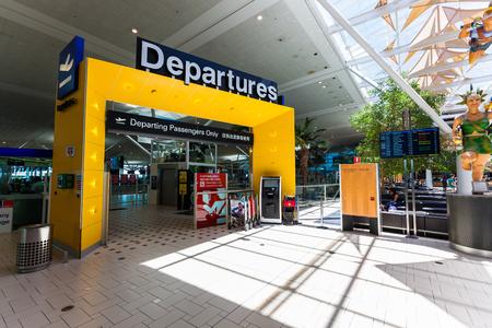 BRISBANE, AUS - DEC 19 2015: Departure passengers gate at Brisbane International Airport.