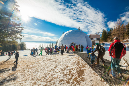 HREBIENOK, SLOVAKIA - JAN 06 2016: Outside view of the Ice Dome, Hrebienok, High Tatras. Its an altar with statues build from ice.