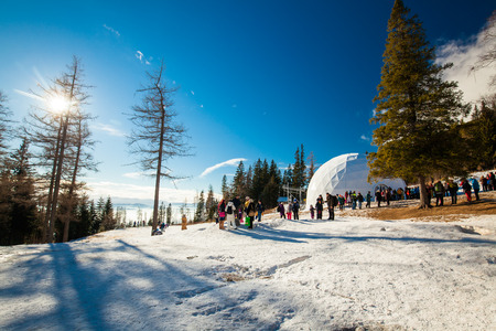 high altar: HREBIENOK, SLOVAKIA - JAN 06 2016: Outside view of the Ice Dome, Hrebienok, High Tatras. Its an altar with statues build from ice.