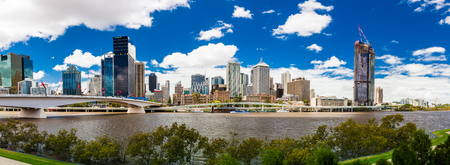 qld: BRISBANE, AUSTRALIA FEB 12 2016: Panoramic view of Brisbane from South Bank over the river. Brisbane is the capital of QLD and the third largest city in Australia.