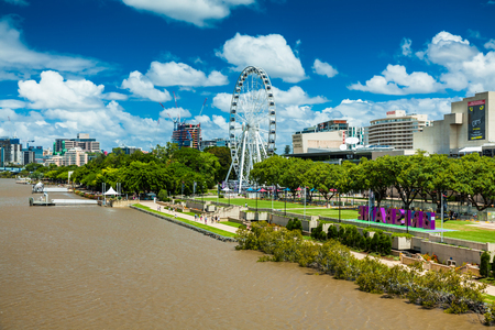 southbank: BRISBANE, AUSTRALIA - FEB 12, 2016: Southbank Parklands and the Brisbane Wheel, located on the southern bank of the Brisbane river.