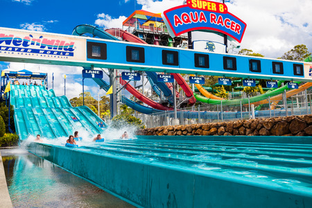 super 8: GOLD COAST, AUS - MAR 20 2016: Visitors riding on Super 8 Aqua Racer in WetnWild Gold Coast water park. Editorial