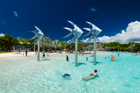 cairns: CAIRNS, AUSTRALIA - 27 MARCH 2016. Tropical swimming lagoon on the Esplanade in Cairns with artificial beach, Queensland, Australia.