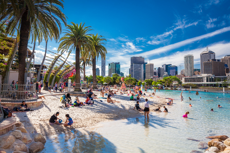 southbank: BRISBANE, AUS - APRIL 17 2016: Streets Beach in South Bank Parkland. Its inner-city man-made beach next to city center.