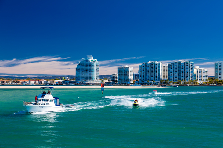 qld: Gold Coast, AUS - SEPT 04 2016 Water sports with the view of Labrador suburb, Gold Coast