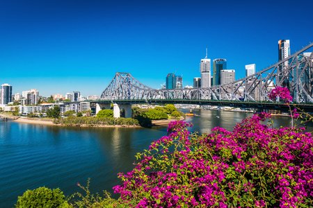 BRISBANE, AUS - AUGUST 9 2016: View of Brisbane Skyline with Story Bridge and the river. It is Australias third largest city, capital of Queensland.