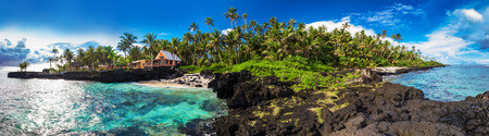 samoa: Panoramic view of coral reef and palm trees on south side of Upolu, Samoa Islands.