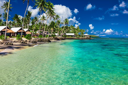samoa: Tropical beach with with coconut palm trees and villas on Samoa Island