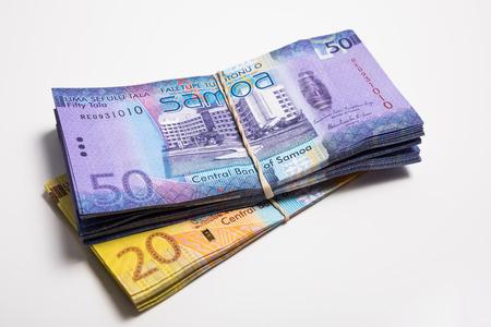 papermoney: Pile of Samoa Tala bank notes isolated on white