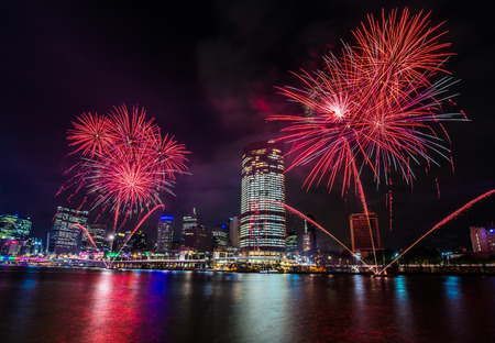 southbank: BRISBANE, AUSTRALIA, DEC 23 2016: Colorful fireworks over night sky in Southbank, Brisbane, Australia