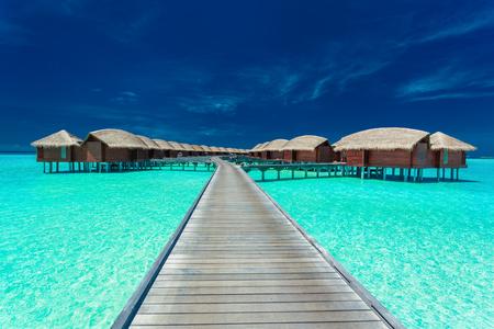 Overwater villas on the tropical lagoon, Maldives islands