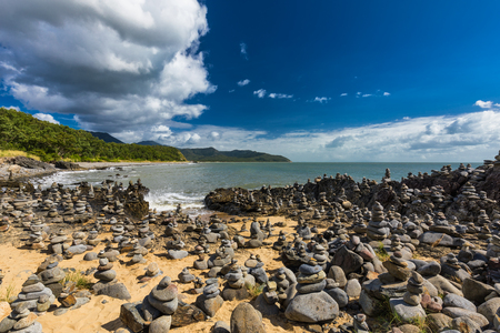 Stacked balancing rocks on the beach between Cairns and Port Douglas, Queensland, Australia