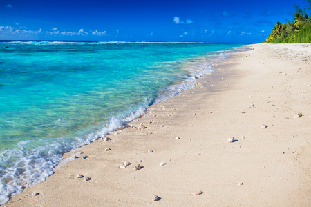 Detail of waves on deserted beach of tropical Rarotonga, Cook Islands, South Pacific Stock Photo