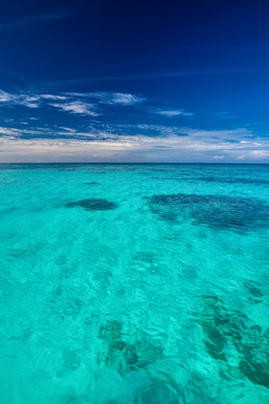 Tropical ocean with blue sky with vibrant ocean colors, Maldives Stock Photo