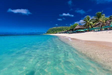 Lalomanu beach with open huts called fales, south side of Upolu Island, Samoa