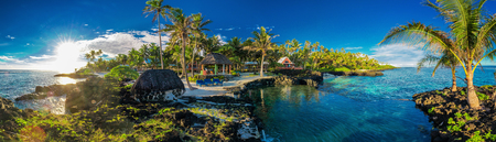Panoramic paradise holoidays location with coral reef and palm trees on south side of Upolu, Samoa Islands. Standard-Bild - 98125651