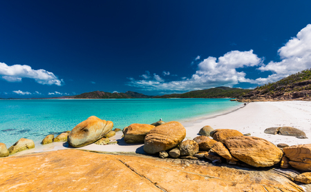 Rocks on the amazing Whitehaven Beach with white sand in the Whitsunday Islands, Queensland, Australia Stock Photo