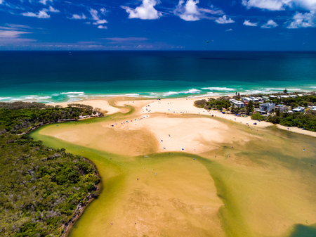 Aerial drone view of beach and Currimundi Lake, Caloundra, Sunshine Coast, Queensland, Australia