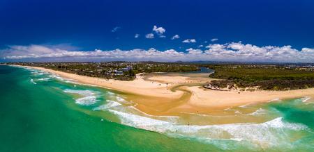 Aerial drone view of beach and Currimundi Lake, Caloundra, Sunshine Coast, Queensland, Australia