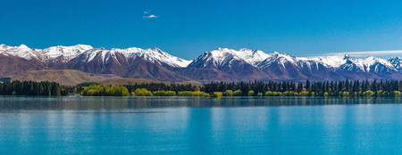 Lake Ruataniwha, New Zealand, South Island, trees and mountains, water reflections