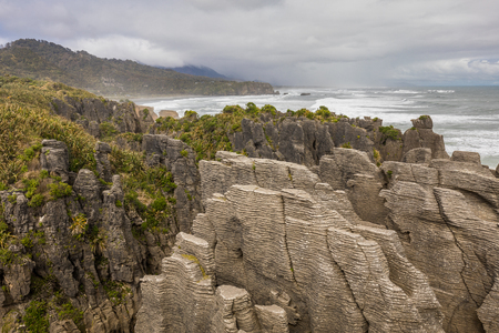 Punakaiki Pancake Rocks with blowholes in the Paparoa National Park, South Island, New Zealand