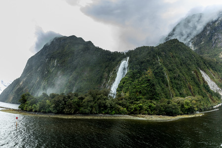 Cloudy and rainy day at amazing and vibrant Milford Sound, South Island, New Zealand