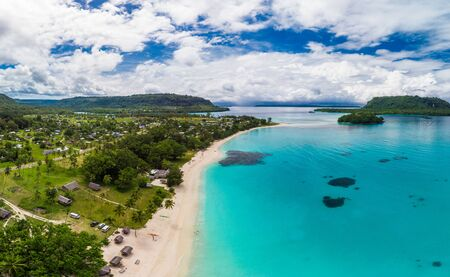 Amazing Port Orly sandy beach with palm trees, Espiritu Santo Island, Vanuatu.