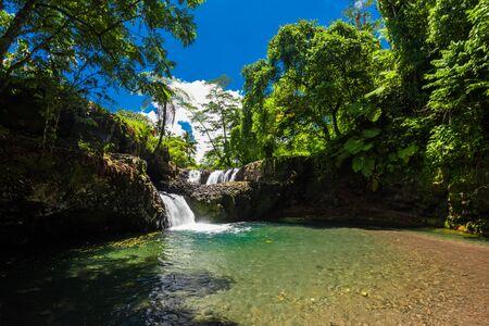 Vibrant Togitogiga falls with swimming hole on Upolu, Samoa Islands.