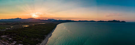 Aerial drone view of a coast line with beach in playa de Muro, Mallorca, Spain