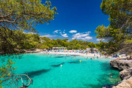 CALA MONDRAGO, Majorka, Spain, 24 July 2020 - People enjoy famous beach in summer, Parque Natural de Mondrago. Santanyi. Malorca. Spain