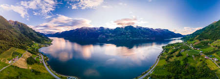 Apple and pear farms in Sorfjorden, lake and mountains, Norway