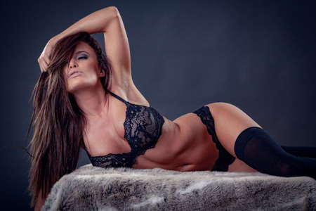 Sexy beautiful Woman in black Lingerie, stockings, bra and garter Imagens