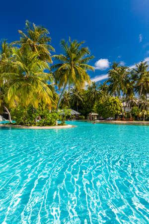 Beautiful summer beach paradise with sandy beach and villas and lagoon Foto de archivo