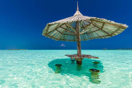 Beautiful summer beach paradise with sandy beach and villas and lagoon