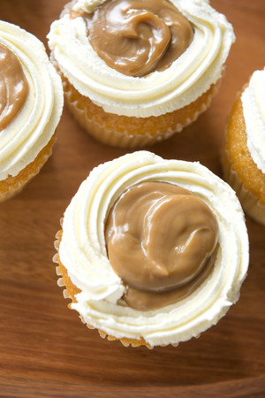 mouth watering: Group of caramel muffins on wood