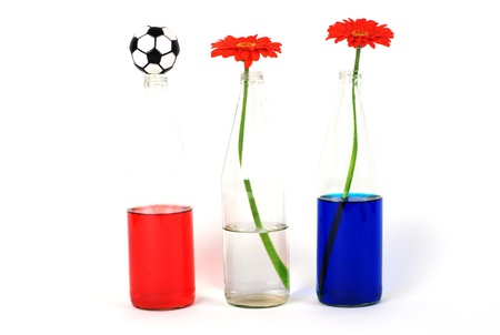 Bottles, flowers and football photo