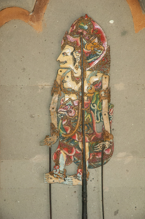 shadow puppets: Ancient Chinese shadow puppet for, hand-painted wood. Bali, Indonesia
