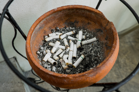 big bin: Smoked Cigarettes Butts in a Dirty Ashtray Big Bin